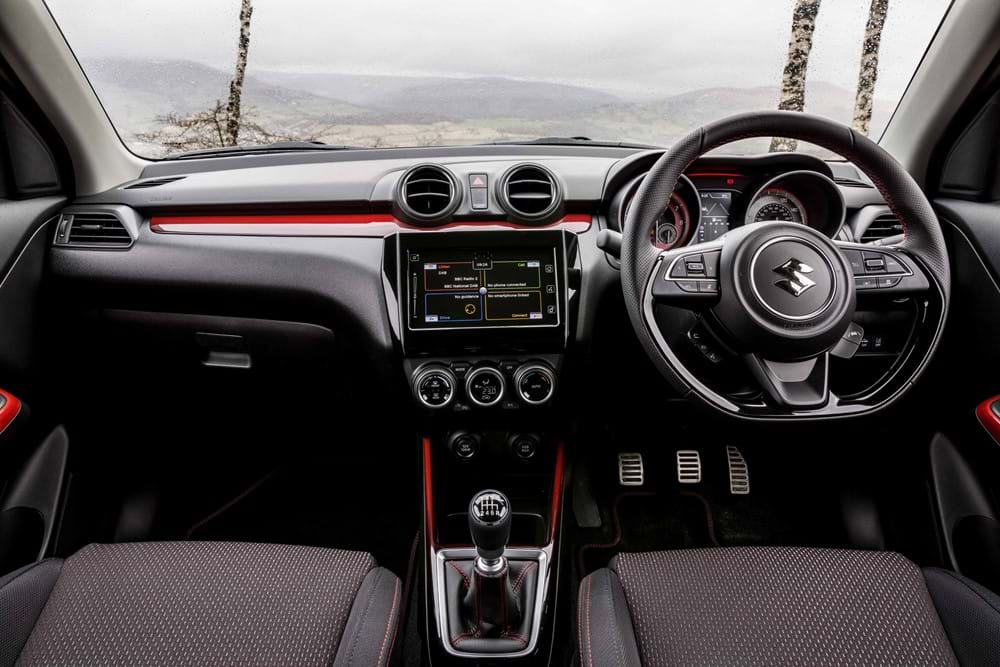 Shot of the dashboard and wheel of the Swift Sport