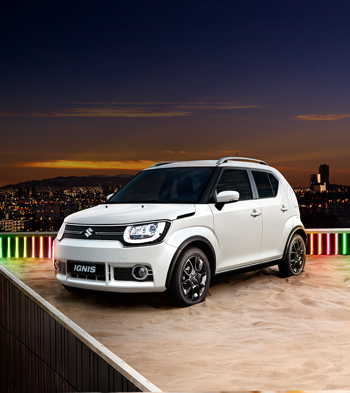 Suzuki Ignis resting on a sandy roof at evening