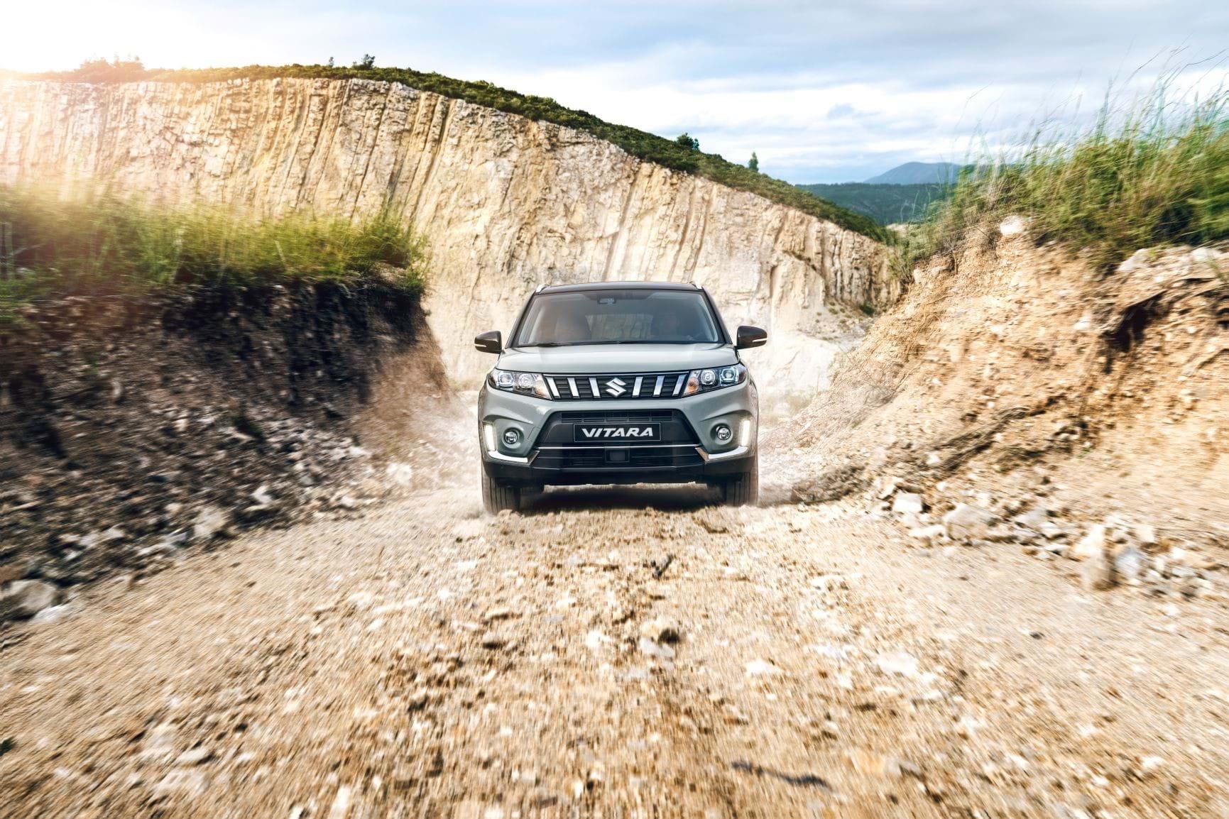 The Vitara driving down a rocky road
