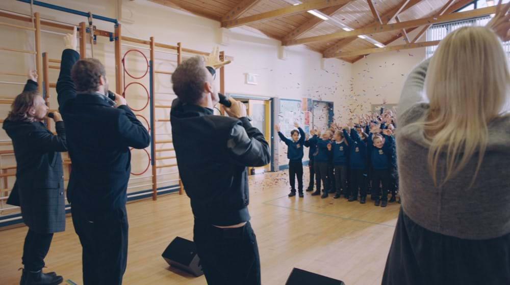 Take That singing in school