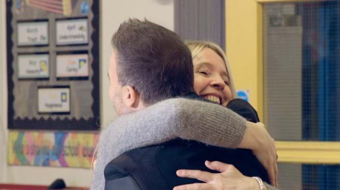 Gary Barlow hugging teacher
