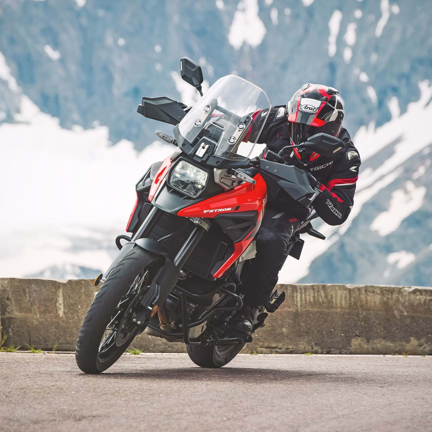 V-Strom 1050XT bike with a mountain range. The Master of Adventure, the best all round adventure bike