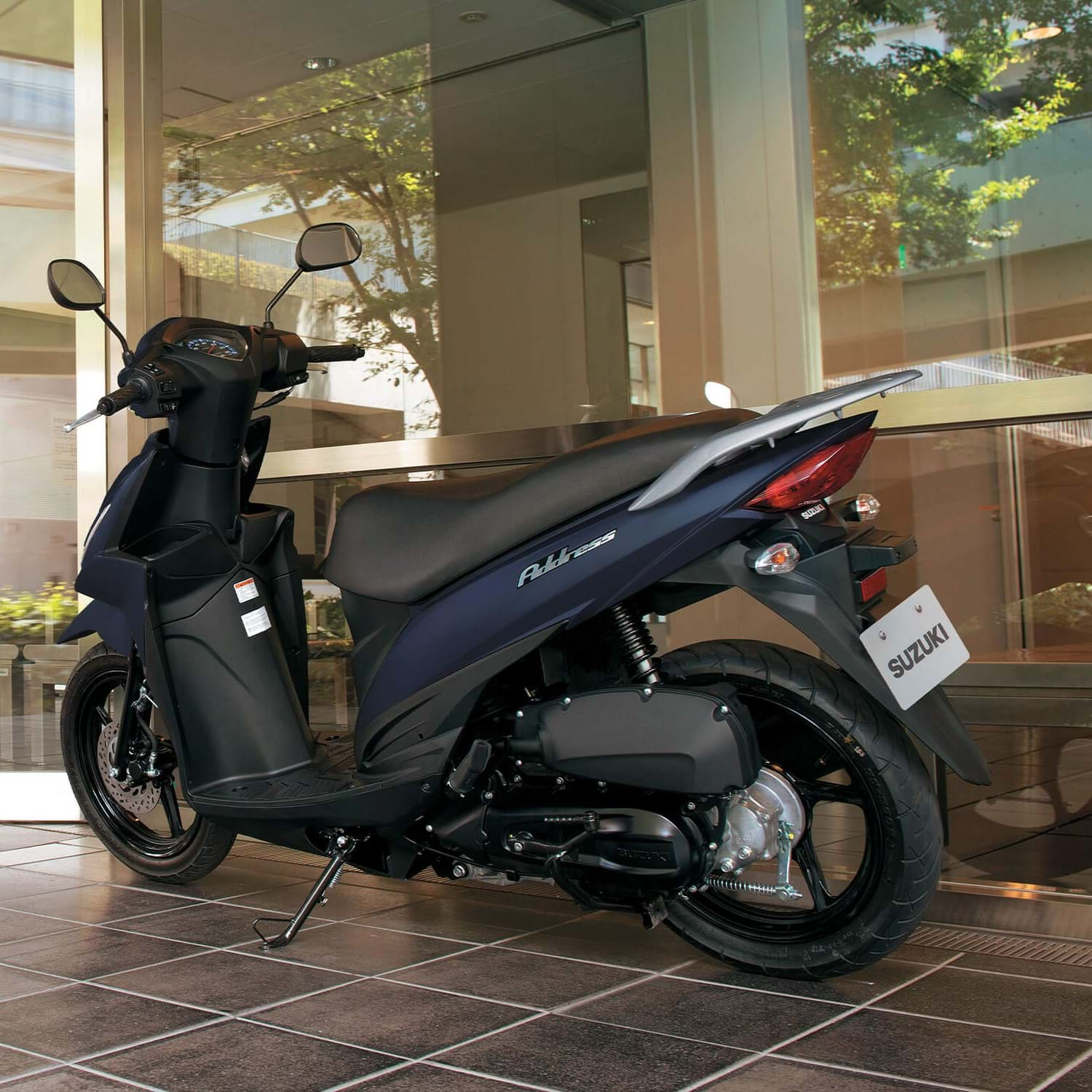Suzuki Address scooter, parked outside office.