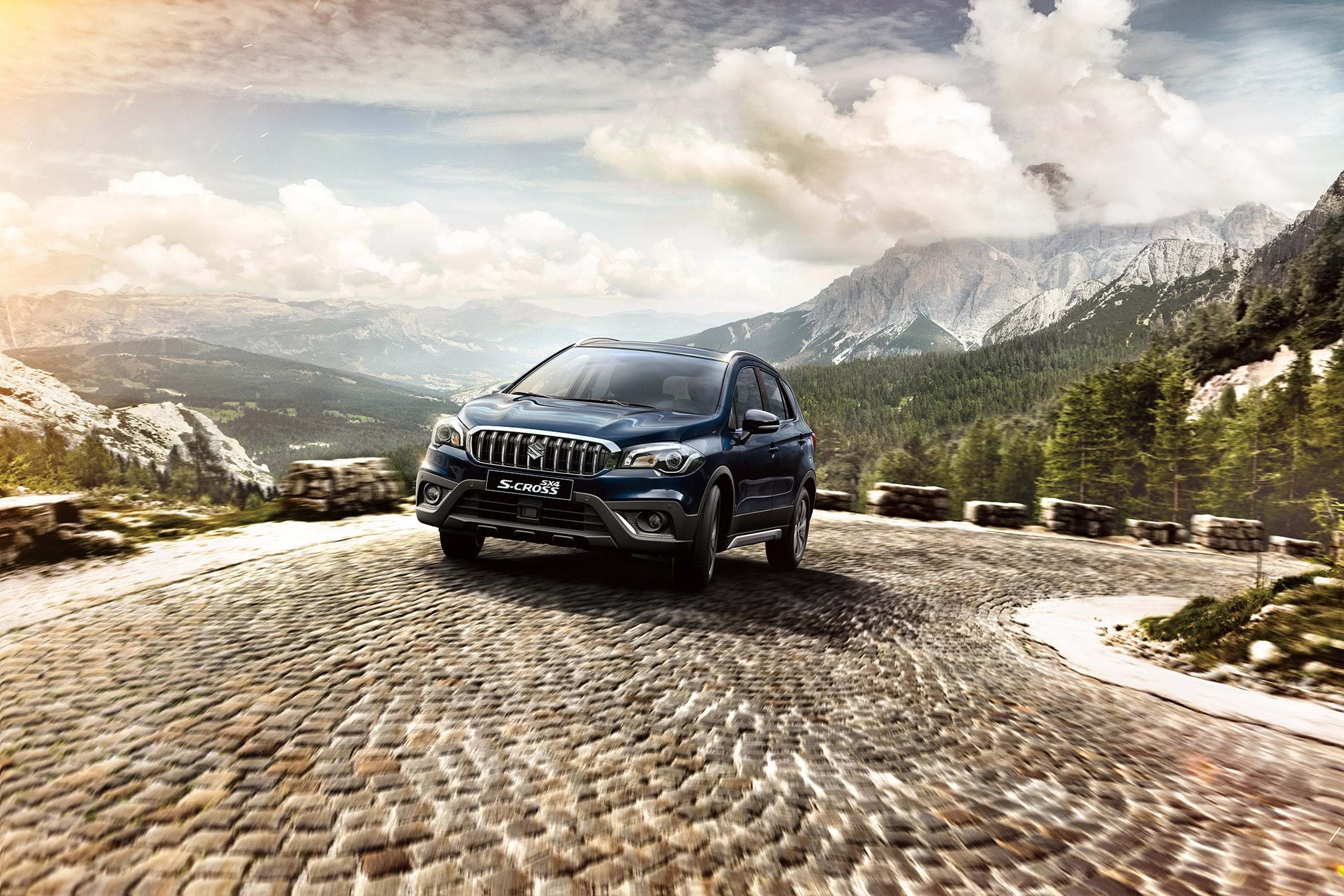 Suzuki S-Cross driving up cobbled road in the mountains