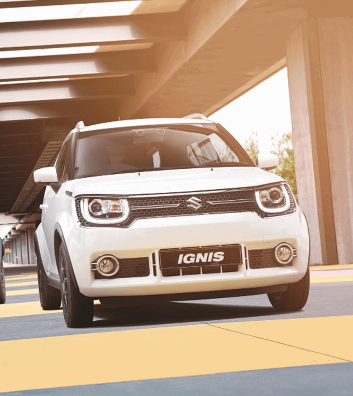 White Suzuki Ignis on the road