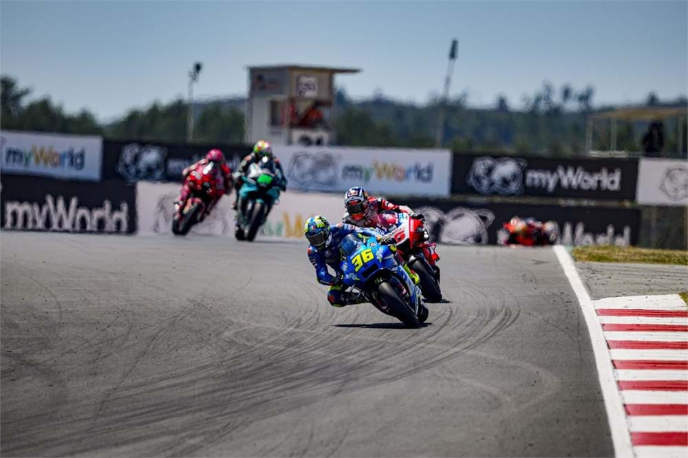 Four riders on a track