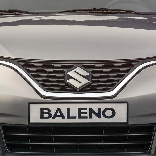 Front facing Suzuki Baleno with front grile with chrome accent