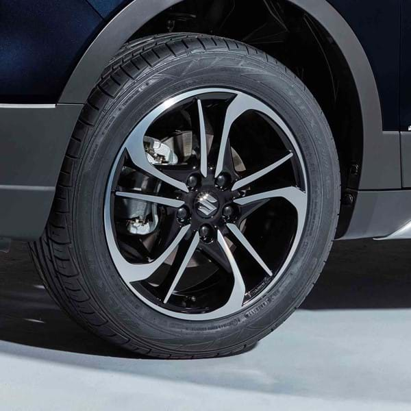 "Close up of Suzuki SX4 S-Cross Stylish 17"" alloy wheels with polished finish"