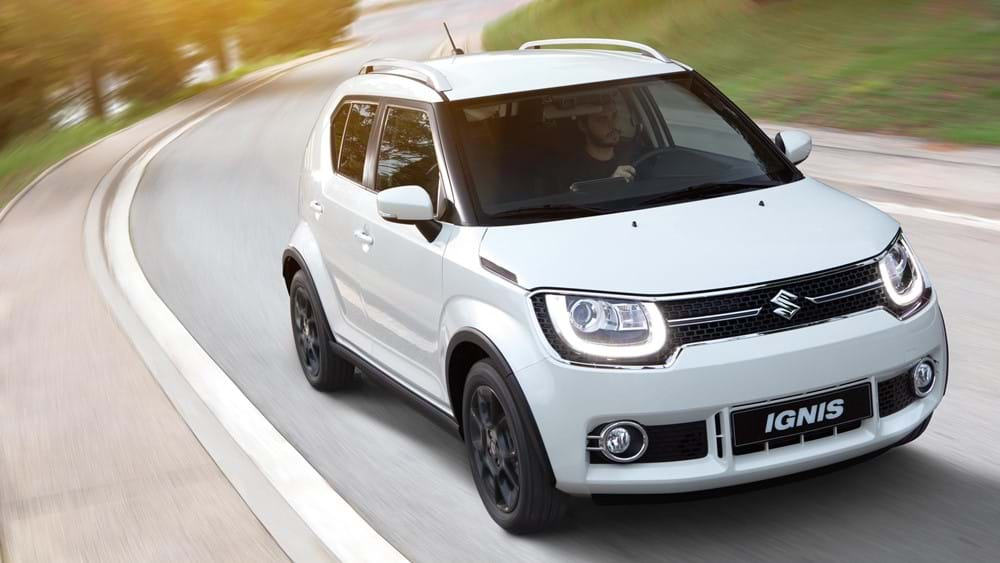 Suzuki Ignis driving on a forest road
