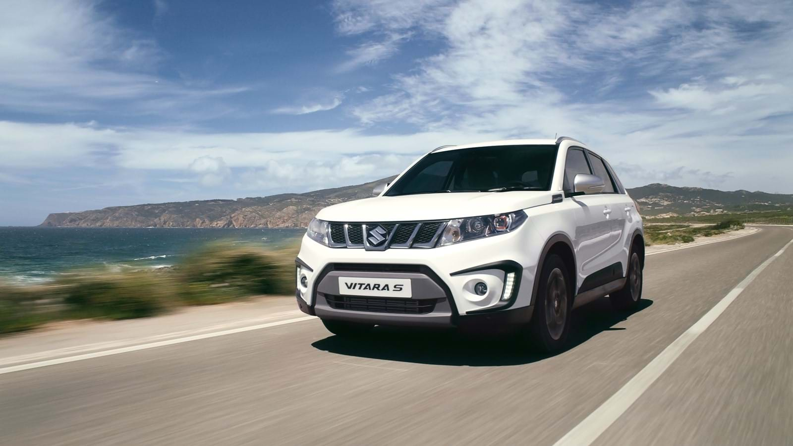 Vitara driving on a coastal road