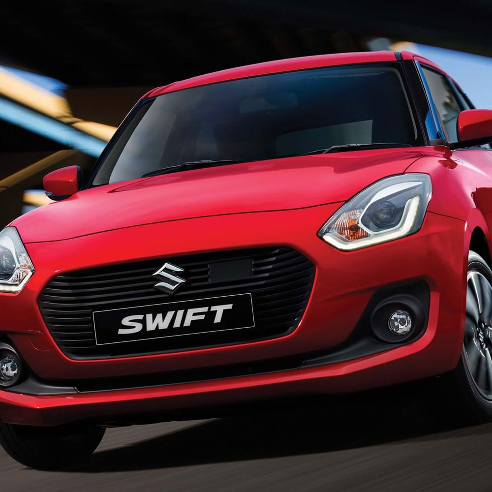 Close up front view of the Suzuki Swift driving