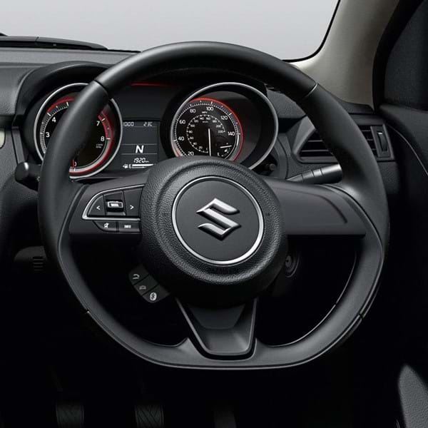 Shot of the Swift's steering wheel and dashboard