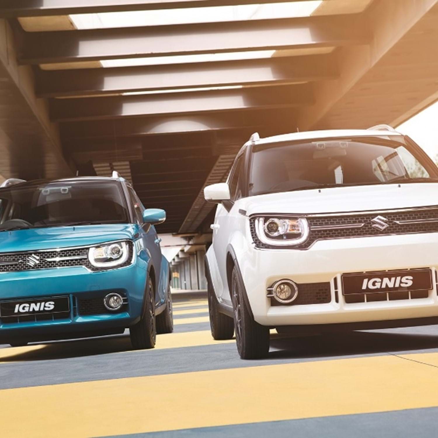 A turquoise and a white Ignis racing
